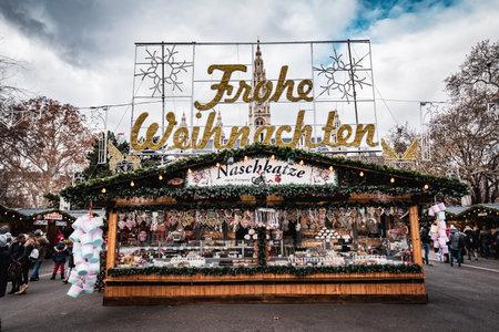 Vienna, Austria - December 10 2018: Day shot of Christmas markets at Rathausplatz, the main text frohe weihnachten behind entrance gate