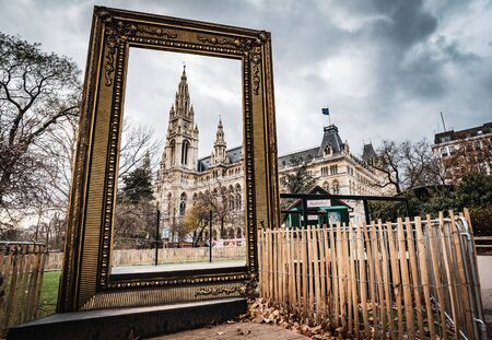 Vienna, Austria - December 10 2018: Day shot of Christmas markets at Rathausplatz, look at the town hall through picture frame