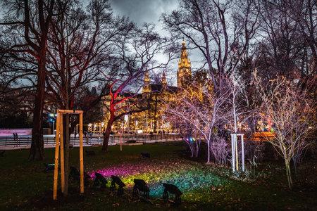 Vienna, Austria - December 10 2018: Night shot of Christmas markets at Rathausplatz, visible town hall in the background Redakční