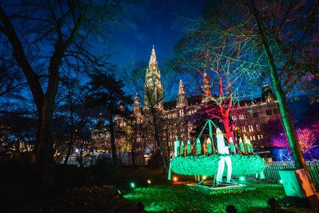 Vienna, Austria - December 10 2018: Night shot of Christmas markets at Rathausplatz, lighted decoration, town hall in the background