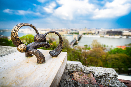 View of Budapest from Budapest Castle Hill Funicular, bronze statuette in the foreground