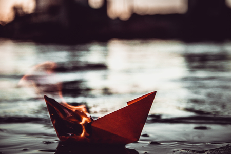 3d boat: Red paper boat on fire