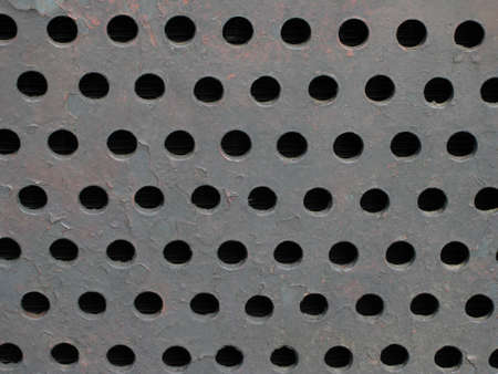 pitted: metal grill texture