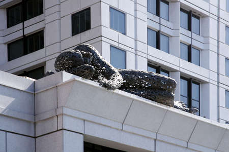 Modern Sculpture on Building Foto de archivo