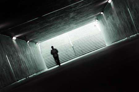 persecution: Dark tunnel Stock Photo