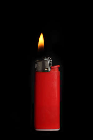 Red lighter on black background photo