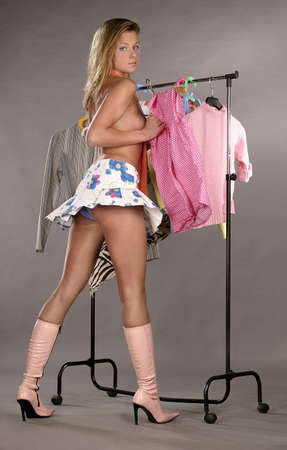 blond girl, young woman trying on clothes photo