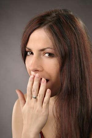 auburn haired girl, young woman yawning-portrait photo