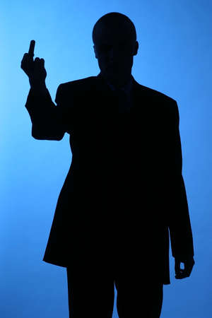 andamp: elegant man standind , showing andamp,quot,andamp,quot, sign -silhouette Stock Photo