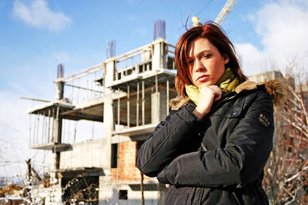 girl, young woman at  a building site- thinking Stock Photo - 552074