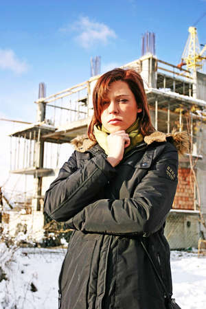 girl, young woman at  a building site- thinking Stock Photo - 552075