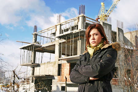 desision: girl, young woman at  a building site- thinking Stock Photo