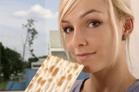 unleavened: blond, young girl, woman eating unleavened bread Stock Photo
