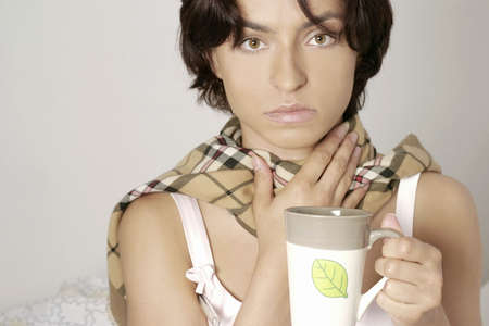 young woman, girl in a scarf drinking from a mug Stock Photo