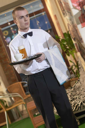 waiter serving beer and coffe in coffe bar Stock Photo
