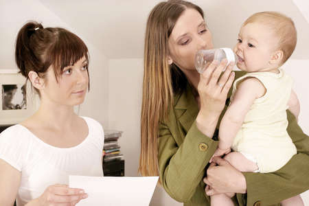 working mother ltalking to a babysitter about her duties