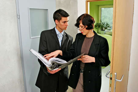 real estate agent showing a flat to a potential client Stock Photo