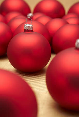 Red christmas decoration on gold background.  photo