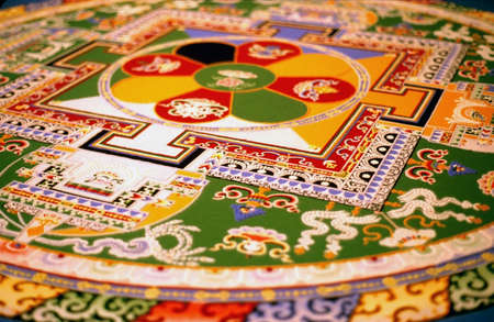 devout: colorful,sand mandala made by Dalaj Lama monks in Warsaw, Poland