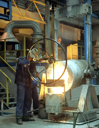 Iron foundry in Klodzko, Poland- moulder at work