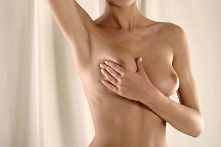 nipples: Cancer prevention-young, white woman touching her brest Stock Photo