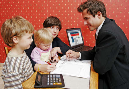 insure: Bank manager with mother and her two children  wanting a loan