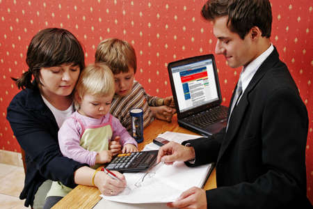 wanting: Bank manager with mother and her two children wanting a loan   Stock Photo