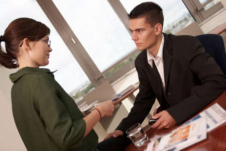 affairs: young manager lets his hand go- sexual harassment at work  Stock Photo