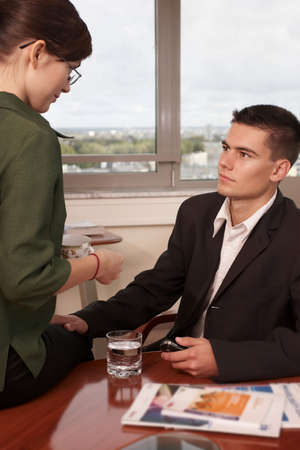young manager lets his hand go- sexual harassment at work