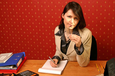 young businesswoman doing some paperwork at her desk Stock Photo - 679735