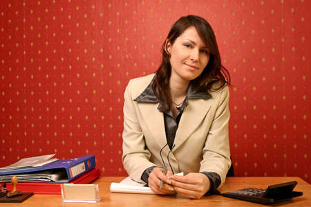 young businesswoman doing some paperwork at her desk Stock Photo - 679736