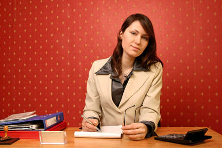 young businesswoman doing some paperwork at her desk Stock Photo - 679737