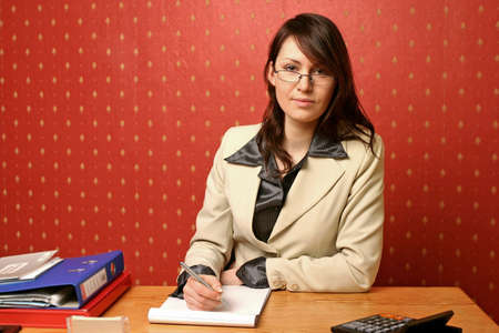 young businesswoman doing some paperwork at her desk Stock Photo - 679738