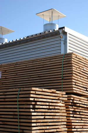forest products: Lumber being processed at a forest products sawmill-storage   Stock Photo