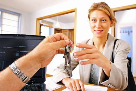 desision: real estate agent handing keys to client, buyer