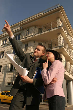 real estate agent showing flat location to potential client
