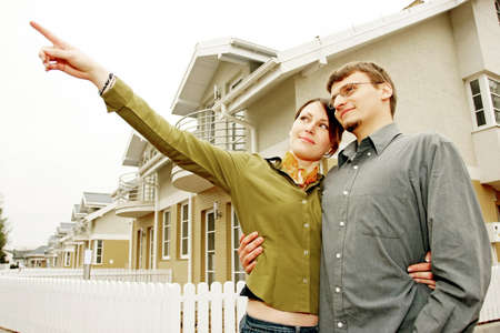 couple in front of one-family house in modern residential area Stock Photo - 679865