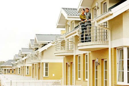 couple in front of one-family house in modern residential area Stock Photo - 679863