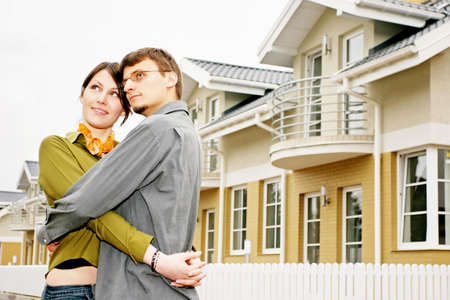 couple in front of one-family house in modern residential area Stock Photo - 679845