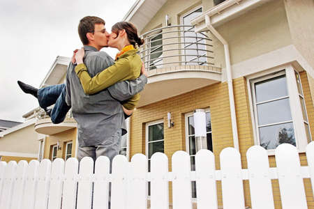 couple in front of one-family house in modern residential area Stock Photo - 679844