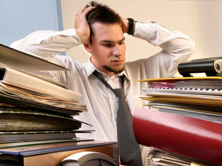 young, white callar worker on his job training  overloaded with work  Stock Photo
