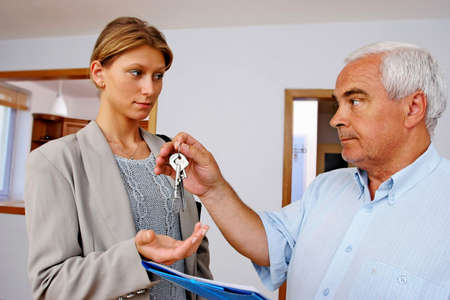 real estate agent handing keys to client, buyer photo