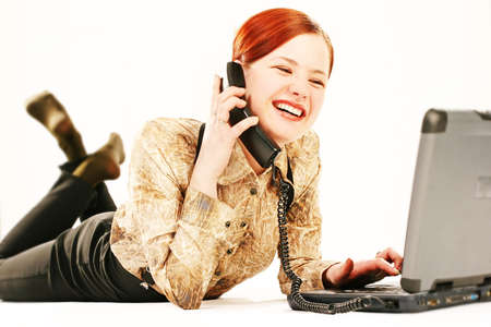 disscuss: working outside your workplace, woman with laptop and receiver Stock Photo