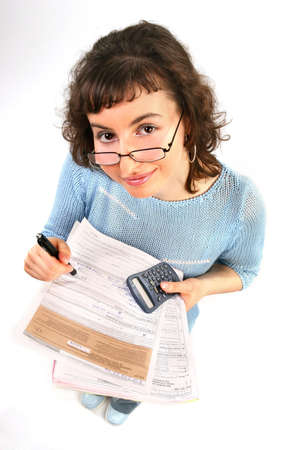 tax form: young woman doing some paperwork-filling tax form on white   Stock Photo