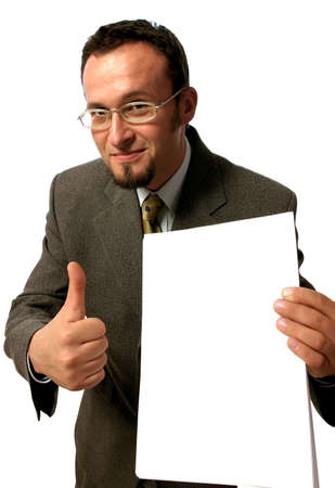 Young handsome  businessman holding  a blank sheet of paper and making an OK sign. Stock Photo