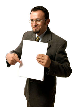 Young handsome  businessman pointing to a blank sheet of paper. Stock Photo