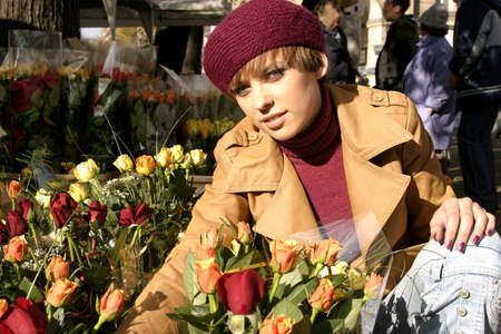 Fashion friendly smiling girl portrait outdoors buying roses. Stock Photo - 2180368
