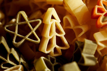 Colourfull christmas decorations- stars and trees made from pasta in close up.  Stock Photo