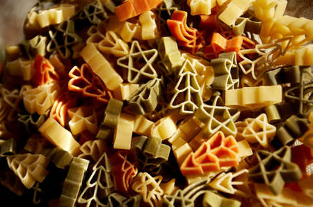 Colourfull christmas decorations- stars and trees made from pasta.