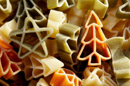 Colourfull christmas decorations- stars and trees made from pasta in close up.  photo